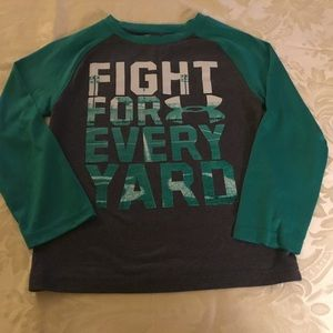 """Under Armour """"Fight For Every Yard"""" Shirt.  Size 4"""
